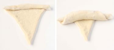 3. Rulla ihop de trekantiga bitarna från den breda sidan mot spetsen.
