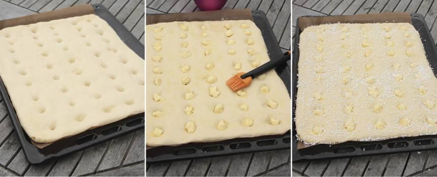 4. Gör ca 45 hål i degen med fingret och tryck ner en bit fryst smörfyllning i varje hål. Pensla med ägg och strö över pärlsocker.