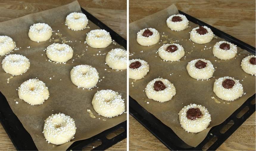 4. Pensla bullarna med ägg och strö över pärlsocker. Tryck till hålet igen om det jäst ihop och lägg en klick Nutellafyllning i varje hål.
