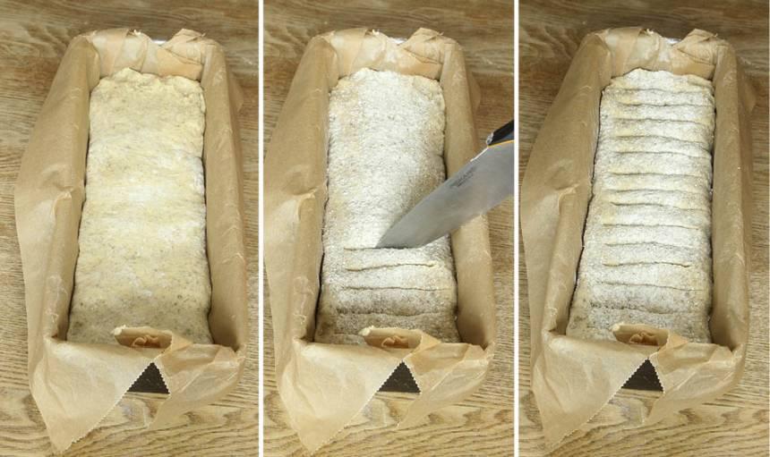 3. Lägg limpan i formen, klädd med bakplåtspapper. Strö över lite rågmjöl. Skär snitt i degen med en vass kniv. Låt degen jäsa övertäckt i kylen över natten.