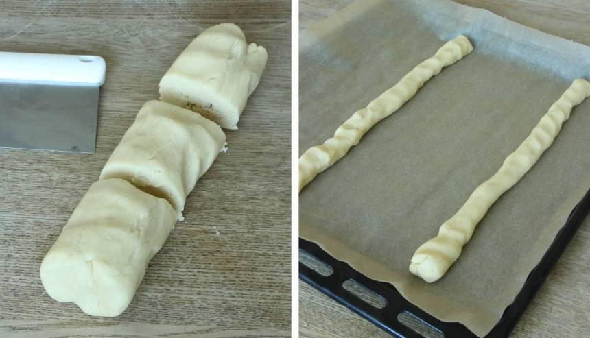 2. Dela degen i tre bitar och rulla dem till längder, 30–35 cm. Lägg dem brett isär på en plåt med bakplåtspapper. Platta till dem något.